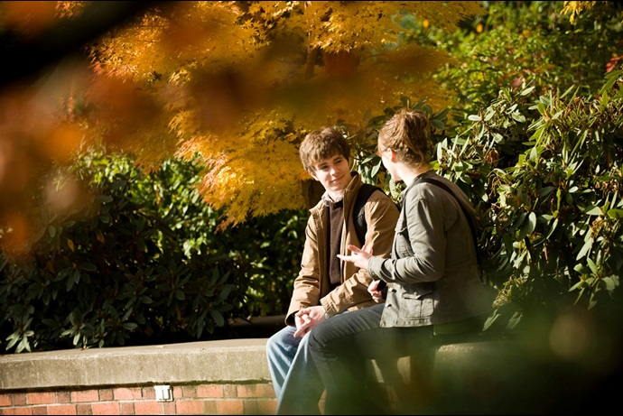 Two students talking outside.